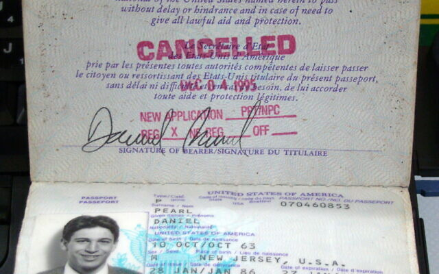 Daniel Pearl's passport, on display in the Newseum, Washington, D.C. (Wikipedia/Author:	Queerbubbles/Attribution-ShareAlike 3.0 Unported (CC BY-SA 3.0)  https://creativecommons.org/licenses/by-sa/3.0/legalcode)
