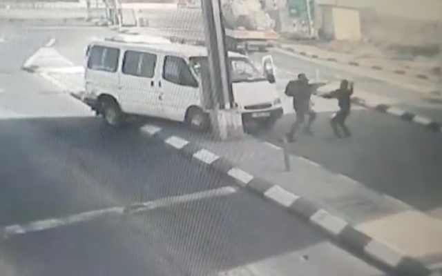 Screenshot from Twitter showing the moment a Palestinian attacker drives his car into a settlement before attempting to stab a police officer