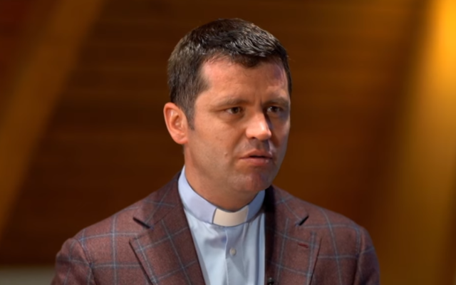 Romanian Catholic priest Francisc Dobos, the spokesperson for the Archdiocese of Bucharest, in 2019. (Screenshot: YouTube via Times of Israel)