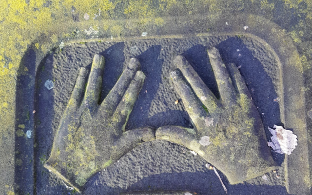 Hands imprinted on a Novo cemetery grave