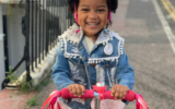 """Three year-old Siena Sendama, pictured, drove 5km on her scooter, having learnt to do so the week before, to raise money for GIFT """"because some people don't have the things that they need."""""""