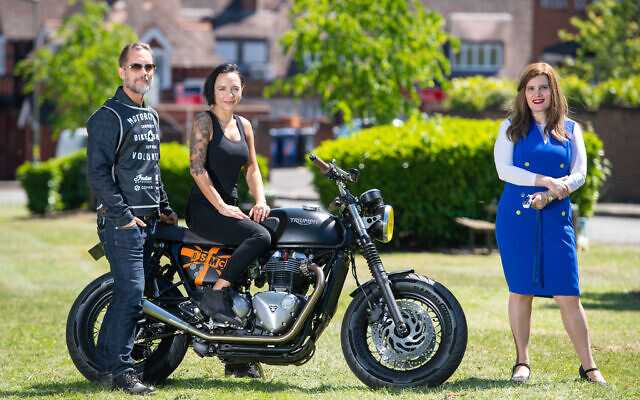 Doctor Sharon Raymond (right) who set up the Urgent Oximeter Rescue service, with founders of the Bike Shed motorbike club Dutch and Vikki van Someren, in Brent Park, north west London. (Photo credit: Dominic Lipinski/PA Wire)