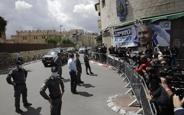 Israeli Prime Minister Benjamin Netanyahu's convoy arrives to Jerusalem district court In Jerusalem, Sunday, May 24, 2020. (AP Photo/Sebastian Scheiner)
