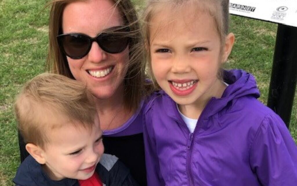 Amy Woolf, the chair of Jewish Care families is pictured with her children Georgia, 5, and Max, 3, participating in the Fun Run