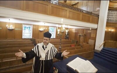 Chazan singing inside his empty shul about longing for communal