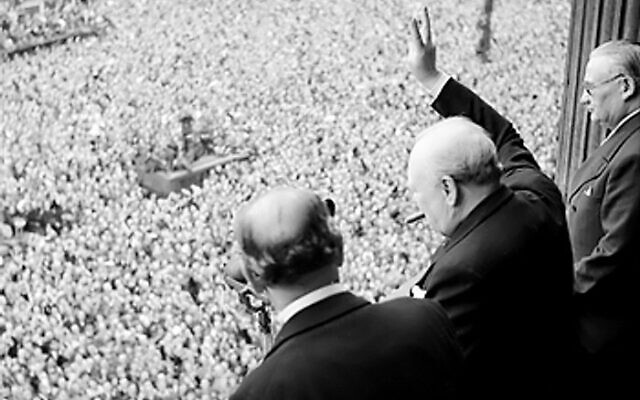 Former PM Winston Churchill waves to crowds in Whitehall on VE Day, 8 May 1945 (Credit: Public Domain, Wikimedia Commons)