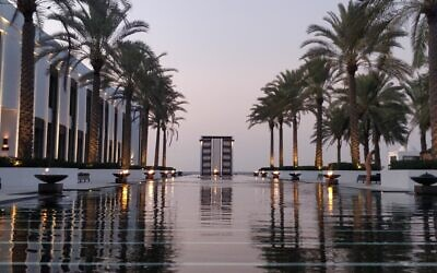 Few things beat an Arabian sunset, best enjoyed at the end of the 103-metre pool at the Chedi, Muscat