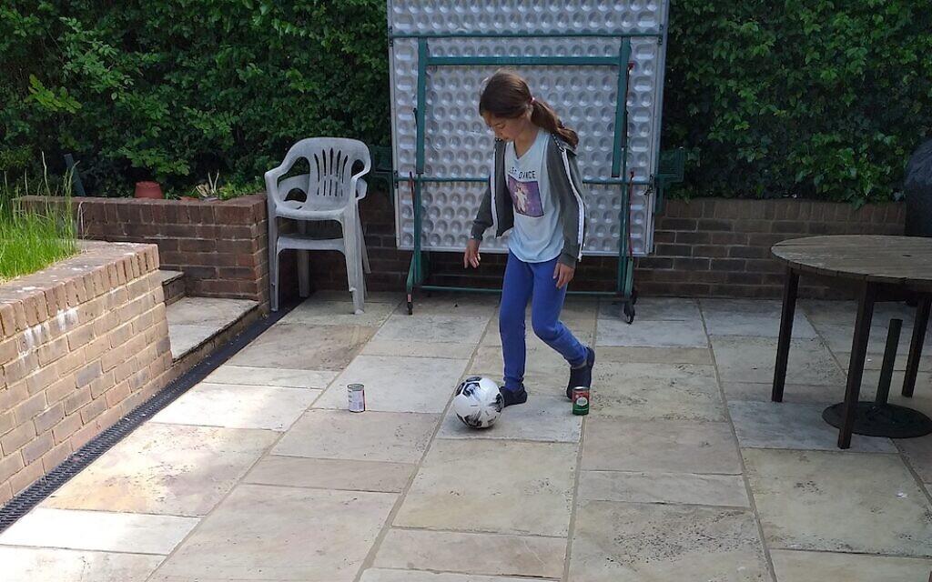 Lucy Waks, 10, playing football!