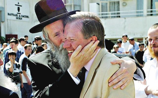 Sherard Cowper-Coles gets a warm greeting from Rabbi Grossman of Migdal HaEmek