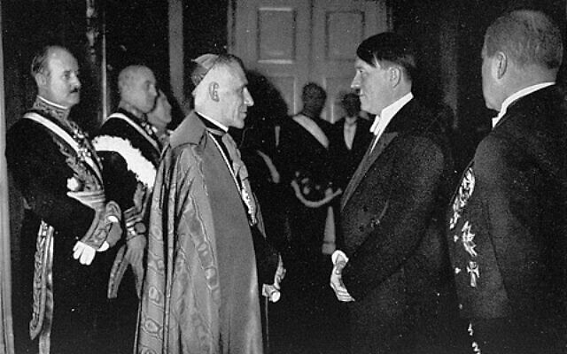 Hitler meeting the Cesare Orsenigo,  Apostolic Nuncio to Germany during the war. January 1, 1935. (Wikipedia/ From the US Holocaust Museum, In the public domain / Author- 	Claireislovely)