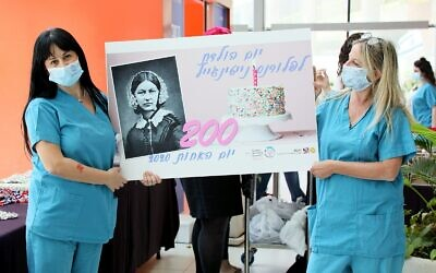 Rambam nurses with gifts celebrating Florence Nightingale's 200th birthday