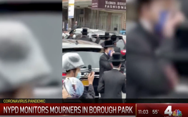Screenshot from NBC New York's video, of the funeral procession being interrupted by Police. (https://www.nbcnewyork.com/on-air/as-seen-on/video-shows-nypd-breaking-up-group-of-mourners-at-holocaust-survivors-funeral/2397657/)