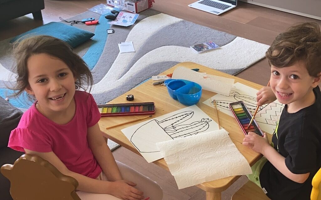Sasha, 7, and Jamie, 5, drawing during the JNFunDay!