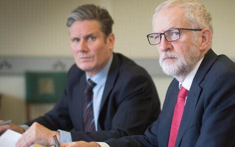 Sir Keir Starmer (left) alongside former Labour leader Jeremy Corbyn (centre)