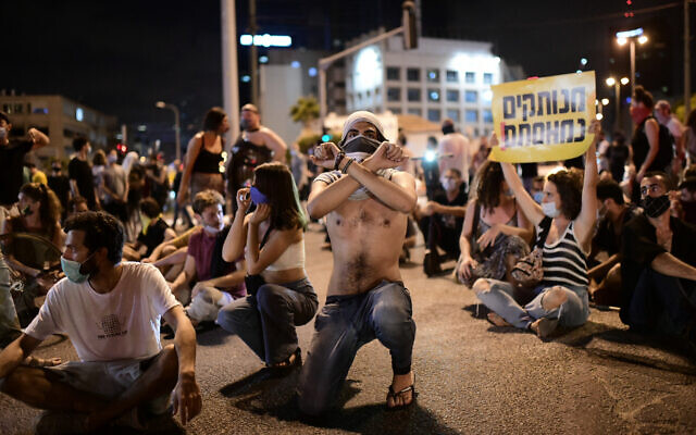 Israelis block a main junction in the city as they protest against the government's response to the financial fallout of the coronavirus disease (COVID- 19) crisis in Tel Aviv, Israel July 11, 2020. Photo by: Tomer Neuberg-JINIPIX