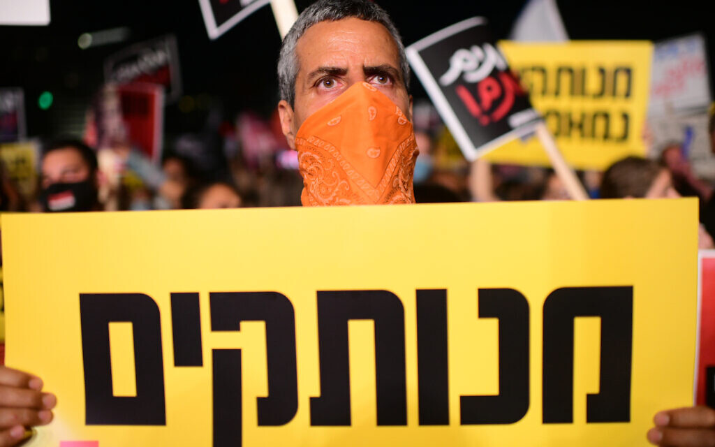 An anti-government protester clad in mask due to the COVID-19 coronavirus pandemic chants slogans during a demonstration in Charles Clore Park in the Mediterranean coastal city of Tel Aviv on July 18, 2020, protesting against the Israeli government and the PM for the broken promises made by the Israeli government during the novel coronavirus pandemic Photo by: Tomer Neuberg-JINIPIX