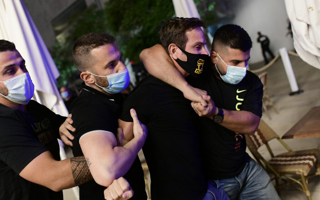 Israeli protesters wearing protective face masks due to the COVID-19 coronavirus pandemic, clash with police during a demonstration on July 18, 2020, in the Israeli coastal city of Tel Aviv to protest against the Israeli government and Prime Minister Benjamin Netanyahu for the broken promises made by the Israeli government during the Covid-19 pandemic. - Israel's government said today it was imposing new restrictions to limit the spiraling spread of coronavirus in the hope of avoiding a general lockdown further along the line. Photo by: Tomer Neuberg-JINIPIX
