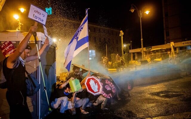 Israeli Police use a water cannon to disperse demonstrators during a protest against Israeli prime minister Benjamin Netanyahu outside the prime minister's residence in Jerusalem on July 26, 2020. Photo by: JINIPIX