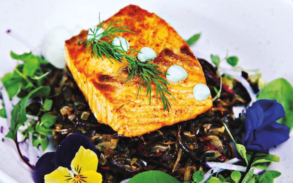 Kushan prepares healthy meals such as curried salmon with confit banana flower