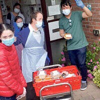 Charity volunteers deliver meals to those in need during the coronavirus lockdown