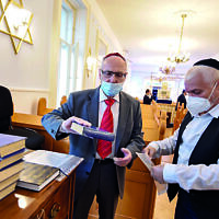 The new normal: gloves and masks are temporary but Covid will also bring lasting changes. This synagogue is in Hungary