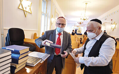 Members of the Jewish community arrive for Friday evening prayers in the rebuilt Thokoly street synagogue in Budapest on June 5, 2020, as Budapest's synagogues reopen following a long closure due to the coronavirus COVID-19 pandemic. (Photo by ATTILA KISBENEDEK / AFP) (Photo by ATTILA KISBENEDEK/AFP via Getty Images)