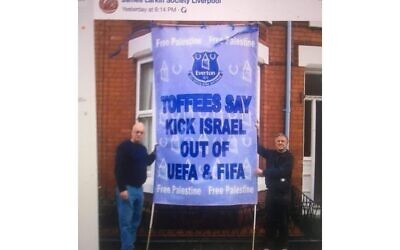 Screenshot of the two activists with the banner.   (Credit: Michelle Langan / Cllr Malcolm Kennedy)