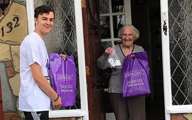 Volunteer Jamie Shone delivers a goody bag to 90 year-old Jewish Care resident Anita Frankle
