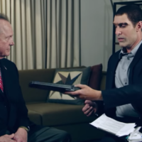 "Roy Moore, left, appearing on Sacha Baron Cohen's show ""Who is America?"" (Screenshot from YouTube via JTA)"