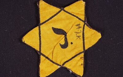 Jewish star worn by Belgian Jews (Wikipedia/ AuthorDRG-fan/  Attribution-ShareAlike 4.0 International (CC BY-SA 4.0)  https://creativecommons.org/licenses/by-sa/4.0/legalcode)