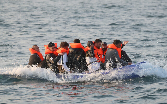 A group of people thought to be migrants crossing the Channel in a small boat headed in the direction of Dover, Kent. (Gareth Fuller/PA Wire)