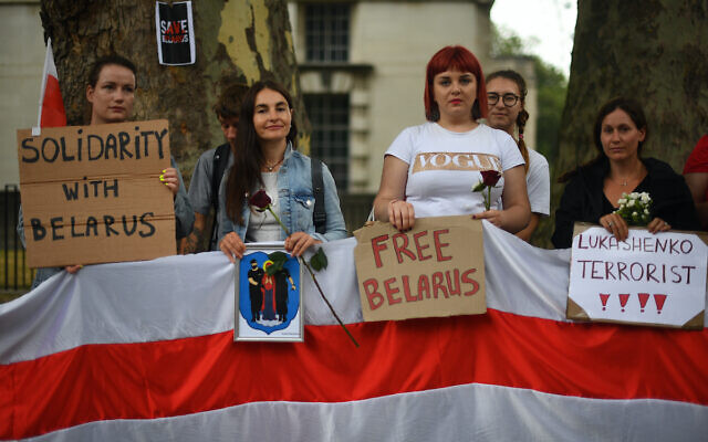 A demonstration outside the Foreign & Commonwealth Office in central London calling for authoritarian President Alexander Lukashenko to resign after 26 years in power following the results of the August 9 Belarus presidential election. (PA Wire/Victoria Jones)