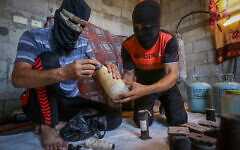 Palestinians prepare balloons attached with flammable materials to be released into Israel from Gaza, in Rafah, southern Gaza Strip, on August 8, 2020. Photo by Abed Rahim Khatib/Flash90