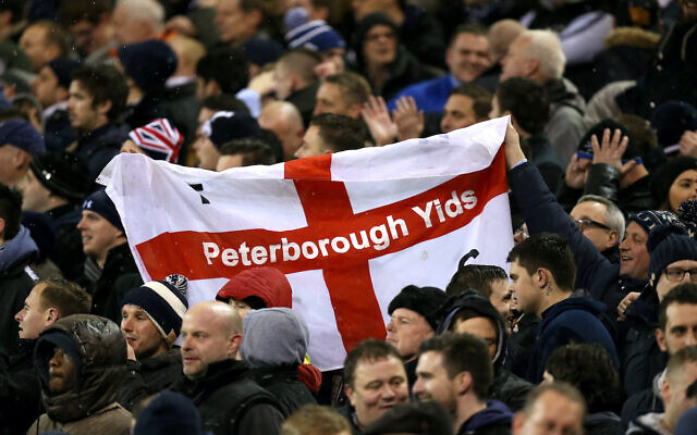 Tottenham Hotspur fans holding a sign with the term 'Yids' in the stands during the Capital One Cup Semi Final, Second Leg at Bramall Lane, Sheffield. (Photo credit: Mike Egerton/PA Wire.)