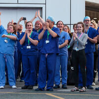 NHS workers come outside during nationwide Clap for Carers NHS initiative