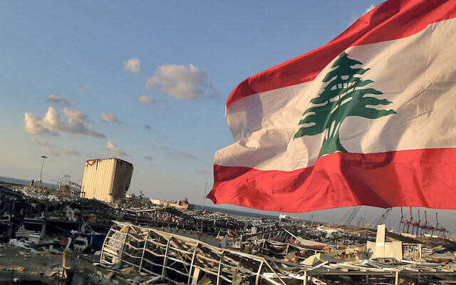 A Lebanese flag flies near the site where a massive explosion blasted the port of Beirut  Photo: Marwan Naamani/dpa
