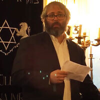 Rabbi Peter Finali speaks at a Budapest synagogue in 2016. (Peter Finali/YouTube via JTA and Times of Israel)