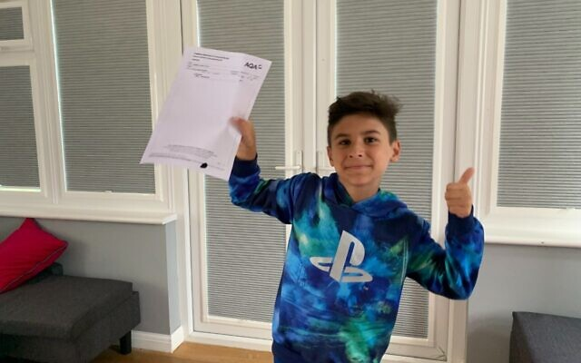 Rafi pictured with his GCSE result (Credit: Family handout)