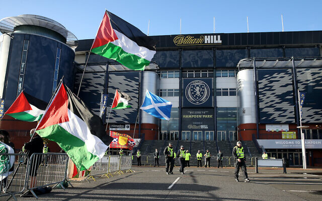 Protesters wave Palestinian flags outside the ground before the UEFA Nations League Group F match at Hampden Park, Glasgow. (PA Wire/Andrew Milligan)