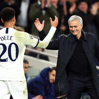 Tottenham Hotspur manager Jose Mourinho shakes hands with Dele Alli. (PA Images/Adam Davy)