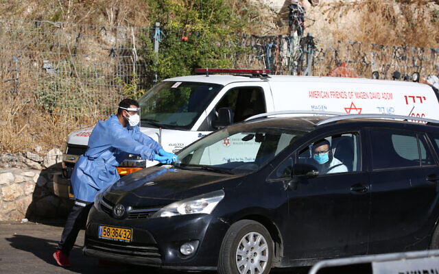 Israeli medical personnel take samples in the northern city of Tzfat.