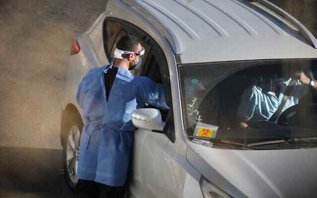 Israeli medical personnel take samples at a drive through COVID-19 testing facility in the northern city of Tzfat, on September, 29 2020. Israel has registered more than 234,060 coronavirus cases with 1,516 deaths, out of a population of nine million. Photo by: David Cohen-JINIPIX