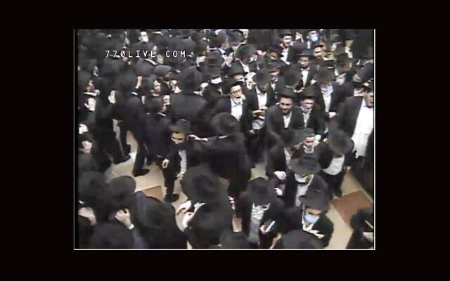 Worshippers danced late into the night at 770 Eastern Parkway in Brooklyn after Selichot services early on Sunday, Sept. 13, 2020. (Screenshot from livestream via JTA)