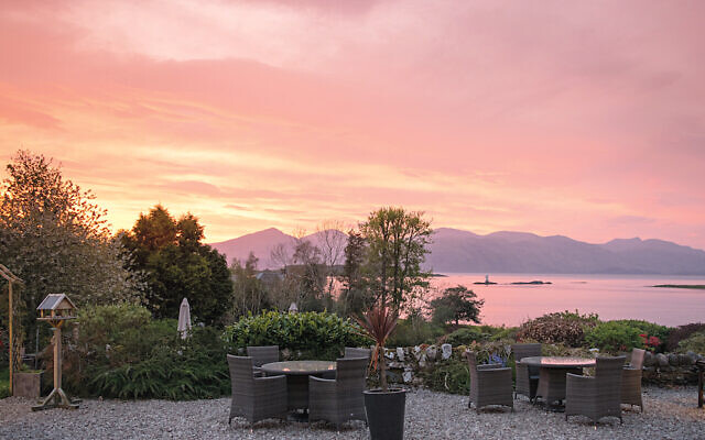 A pink sunset viewed from the terrace at Airds Hotel