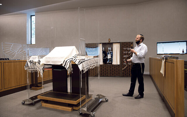 Anti-virus screens around the bimah at South Hampstead synagogue