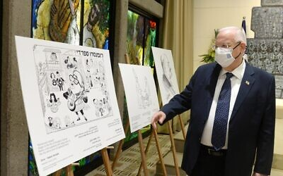 President Rivlin inspects cartoons at the exhibit