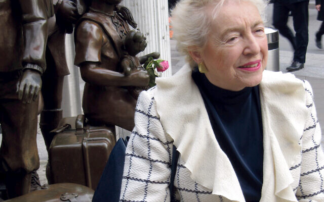 Dame Stephanie Shirley, who was born in Austria,  next to the iconic kinder statue