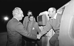 Then Israeli Prime Minister Shimon Peres welcomes Natan Sharansky as he lands in Israel straight from his release in 1986