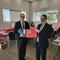 Packing room with Rabbi Daniel Rowe and Rabbi Dovid Lichtig