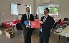 Packing room with Rabbi Daniel Rowe and Rabbi Dovid Lichtig